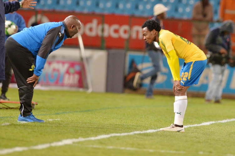 Mamelodi Sundowns head coach Pitso Mosimane chats to his star forward Percy Tau during the Absa Premiership match against Polokwane City at Loftus Versfeld Stadium on August 22, 2017 in Pretoria, South Africa.