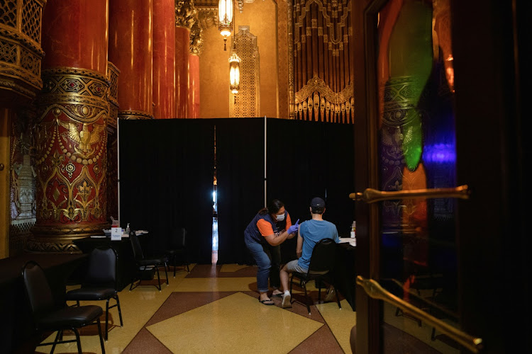 A person receives their coronavirus vaccine at a pop-up vaccination clinic at the Fox Theater in Detroit, Michigan, US, on June 11 2021.