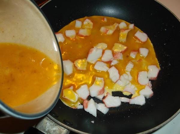 Pour beaten egg into pan.