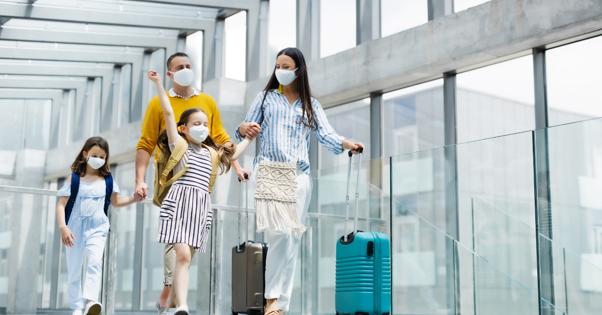 Family with masks on an Airport