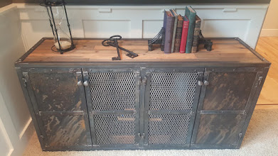 Photo: This piece was inspired by 19th Century machine shops which used similar units to store steel tooling dies. The reclaimed wood top paired with industrial steel doors and frame create a rich juxtaposition that will add texture and character to any space. Each piece is unique and will tell a story in any gathering space for years to come.  The doors can be rearranged and the patina patterns can be changed over time to suit personal preference. There is room for customization as listed in the options.  Investment: 1200-1700