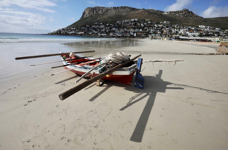 Not a soul on Fish Hoek beach as police enforce a ban under level 3 lockdown. We cannot shame people into safe behaviours or enforce policy by bullying surfers and bathers on the beaches, argues the author.