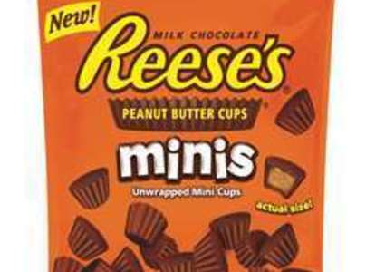 Pour bag of mini Reese's over warm cereal mix.  Add nuts and marshmallows.