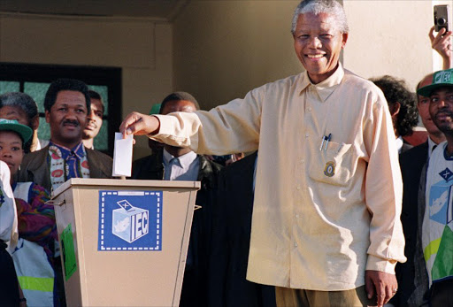 African National Congress (ANC) President Nelson Mandela smiles broadly 27 April 1994 in Oshlange, black township near Durban, as he casts his historic vote during South Africa's first democratic and all-race general elections. File photo