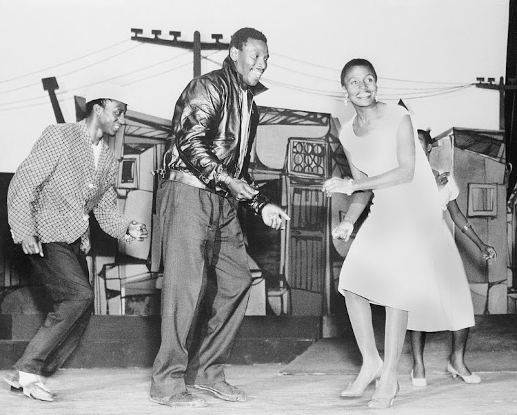 Scene from 'King Kong', Johannesburg: singer Nathan Mdledle (center), as King Kong, dances with his gangster-moll girl friend-played by Miriam Makeba, at an illicit liquor den.