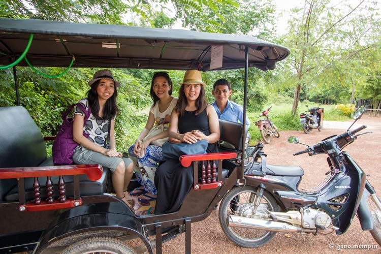 A tuktuk driver taking passengers on a temple tour in Siem Reap.