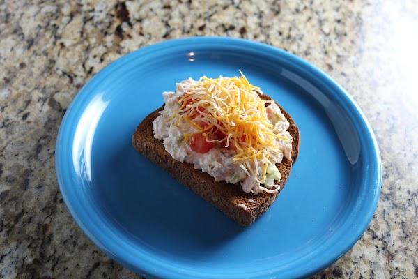 Toast 1 slice of whole grain bread. Put tuna mixture onto bread. Add tomato...