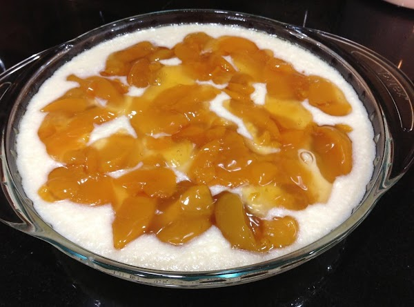 Pour mixture into baking dish, drop pie filling randomly by large spoonfuls on top...