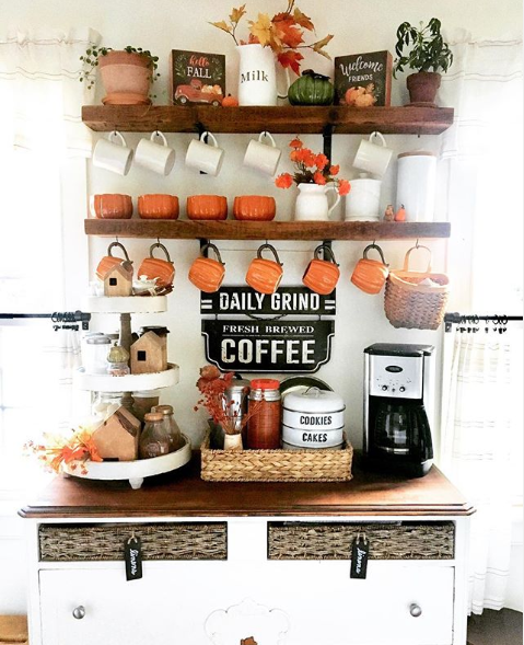 kitchen coffee bar station with fall-themed coffee accessories, fall signs, 3 tiered white tray and fall flowers