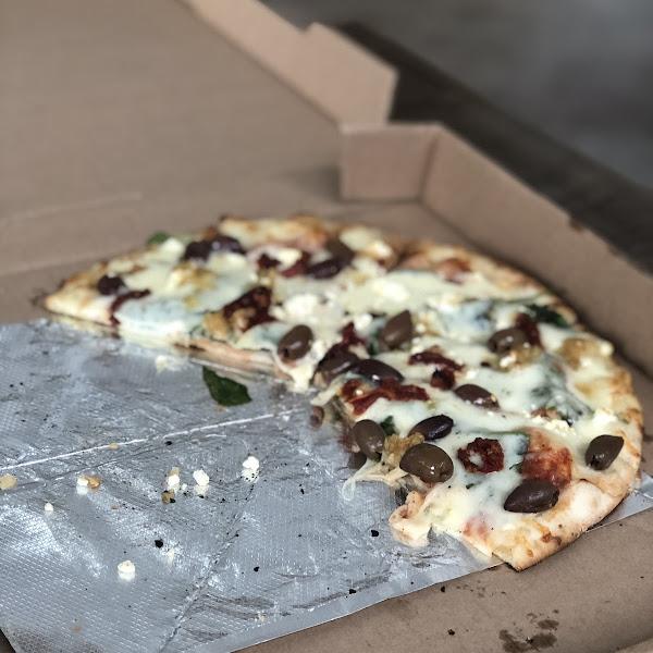 Mediterranean Pizza on Cauliflower Crust - so good!!!