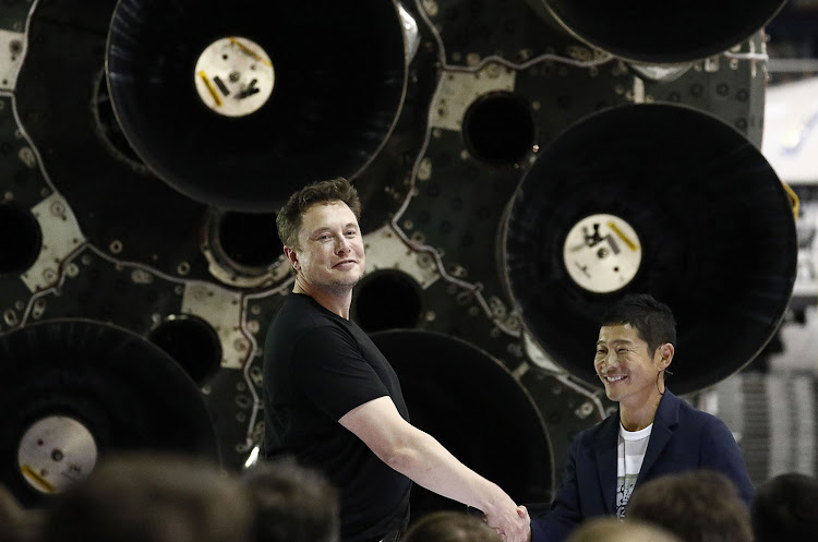 Elon Musk and Yusaku Maezawa at event at the SpaceX headquarters.