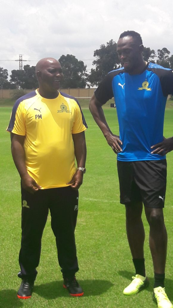 Retired Jamaican athletic superstar Usain Bolt and Mamelodi Sundowns coach Pitso Mosimane.
