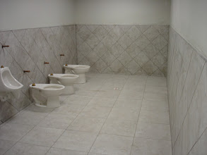 Photo: commercial bathroom job installation tiled wall& floor