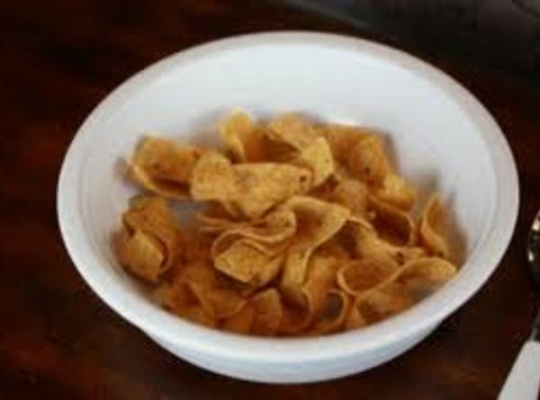 Line serving dishes with Fritos on bottom and sides.