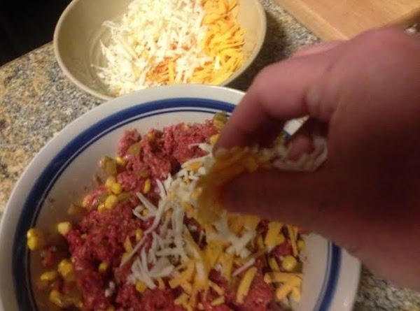 Combine ground beef with onion, egg, salt, pepper, cumin, green chiles, corn, ¼ cup...
