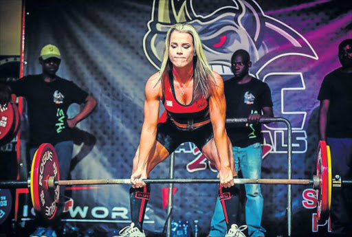 POWER PACKAGE: EL's Toinee Botha, who recently won gold at the national weight-lifting championships in Pretoria Picture: SUPPLIED
