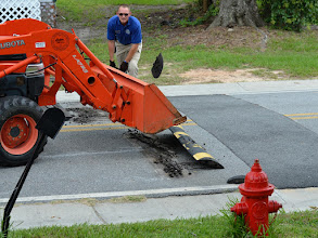 Photo: The city is pulling up the speedbumps on the street where I have my shop.