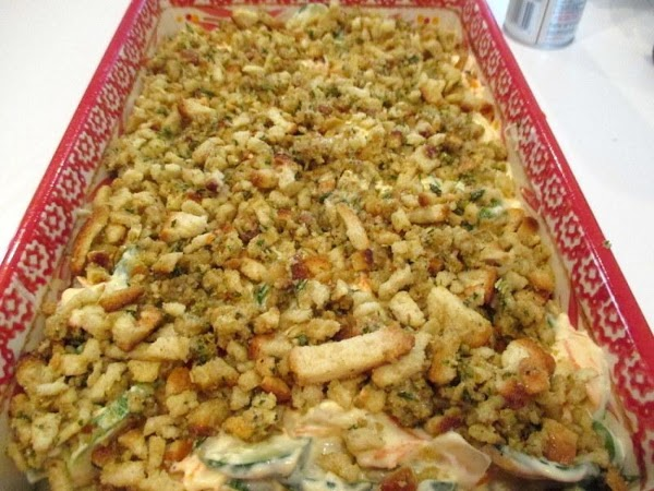 Spread the zucchini mixture over the crumbs, then top with remaining crumbs. Cover with foil...