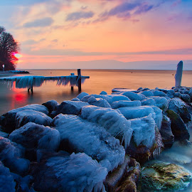 sunset on ice by Renaud Igor - Landscapes Waterscapes