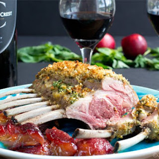 Mint and Basil Pesto Crusted Rack of Lamb with Roasted Plums