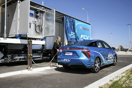 The Toyota Mirai fuel-cell vehicle alongside the mobile refuelling truck.  Picture: TOYOTA