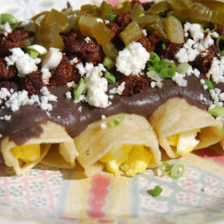 Enchiladas with Chipotle Black Bean Sauce, Chorizo and Queso Fresco.