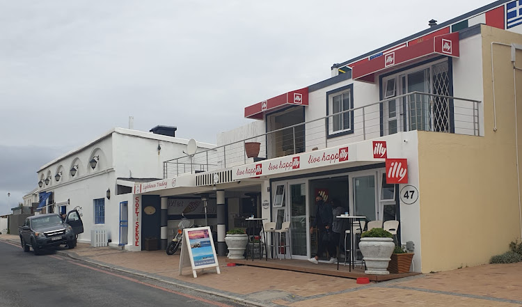 Jerry Finley's Pinard on Sea guesthouse, right, neighbours Andre Bezuidenhout's On the Rocks restaurant in Bloubergstrand, Cape Town.