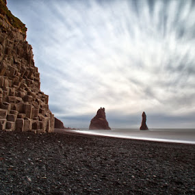 The black beach in Iceland by Tim Vollmer - Landscapes Beaches ( clouds, iceland, vik, black beach, sea stacks, stone, long exposure, ocean, beach, reynisdrangar, basalt )