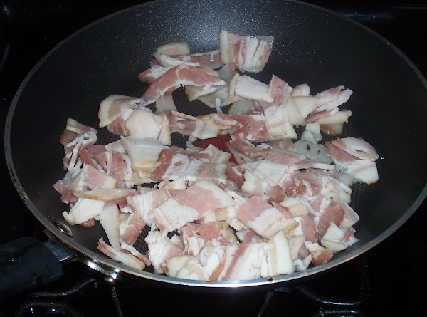 Cut bacon into 1 inch pieces.  Saute until brown and crisp. Remove from...