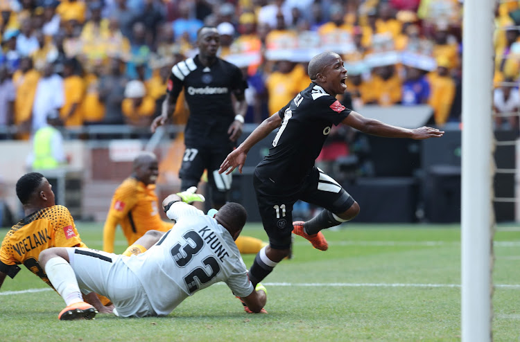 Luvuyo Memela scores past Itumeleng Khune of Kaizer Chiefs during the Absa Premiership match between Orlando Pirates and Kaizer Chiefs at Soccer City, Soweto on 03 March 2018.