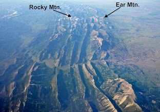 Photo: The Rocky Mountain Front: Gibson Dam on the Sun River can be seen below the center of the photo. Rocky Mountain is the highest peak in the Sawtooth Range.