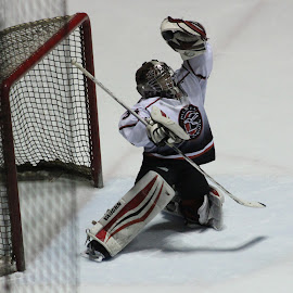 By the tip of the glove by Marsha Grimm - Sports & Fitness Ice hockey ( hockey, glove, save, ice, youth,  )