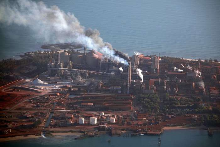 Smoke billows from chimneys at the Rio Tinto alumina refinery. Picture: REUTERS