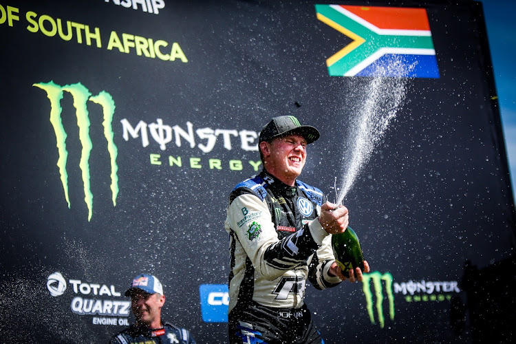 Johan Kristoffersson celebrates on the podium after taking his 11th World RX victory of the season. Picture: SUPPLIED