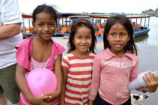Three young girls were happy to see travelers from the U.S. visit Cambodia.