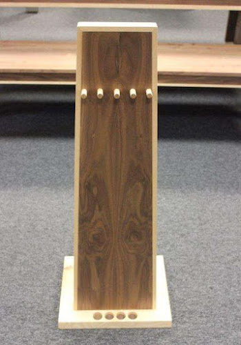 a monolith shaped pool cue from the front