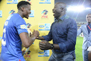 Thamsanqa Gabuza of SuperSport United FC and SuperSport United head coach Kaitano Tembo share some light moment during the MTN 8 final match between Highlands Park and SuperSport United at Orlando Stadium on October 05, 2019 in Johannesburg, South Africa.