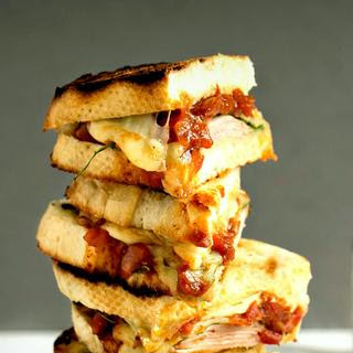 Moroccan Tomato Grilled Cheese Sandwich with Ham and Spinach.