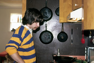 Photo: Andy Goodrich, cooking, the Goodrich East Park Place house, Ann Arbor, Michigan, USA, c. 1976
