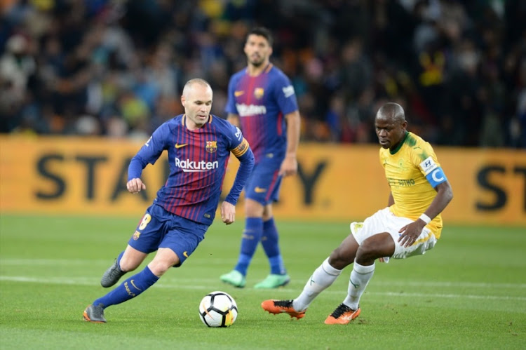 Andres Iniesta of Barcelona FC and Hlompho Kekana of Mamelodi Sundowns during the International Club Friendly match between Mamelodi Sundowns and Barcelona FC at FNB Stadium on May 16, 2018 in Johannesburg, South Africa.