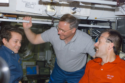 Bursch, Ross and Smith talk in Zvezda during STS-110's visit to the ISS