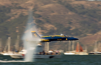 Photo: One of the most incredible aircraft photos I've ever scene.   A U.S. Navy Blue Angels F/A-18 Hornet Fighter Jet Flying Low Over the Water at Speeds Just Under Mach 1  A Sneak Pass Maneuver Performed By the Lead Solo, October 9, 2005 San Francisco, State of California, USA Source, more info and some other amazing transonic photos: http://www.thelivingmoon.com/45jack_files/03files/Transonic_Clouds_Page_03.html