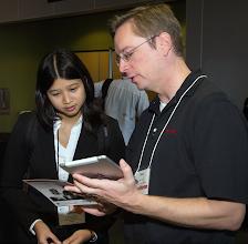 Photo: Matt Pittard, UT B '01,from Raytheon discusses employment opportunities with Kathryn Chung, FL Q '15.