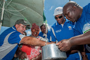 Eastern Cape premier candidate Nqaba Bhanga, right, DA leader Mmusi Maimane, second from right, and axed Nelson Mandela Bay mayor, Athol Trollip, left, on January 9 2016