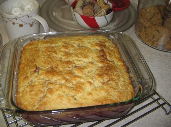 With a slotted spoon scoop cranberries from sauce and place in bottom of an...