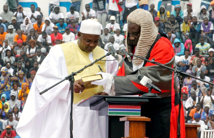 Oath of office: New Gambian President Adama Barrow takes the oath of office at Independence Stadium in Bakau, west of the capital Banjul, on Saturday. Picture: REUTERS/THIERRY GOUEGNON
