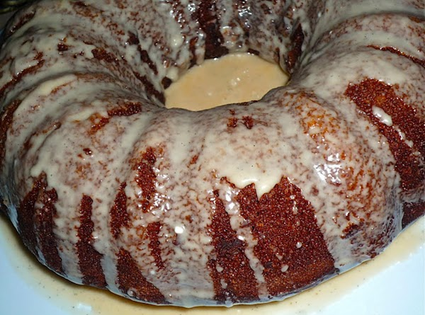 Pour batter into 3 greased bread pans or one bundt pan that has been...