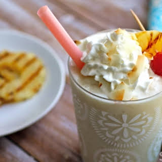 Grilled Pineapple Frozen Piña Colada Cocktail With Toasted Coconut.