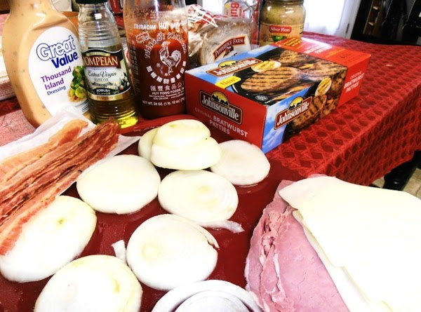 gather ingredients.  thaw burgers.  brush onion slice with olive oil.  mix