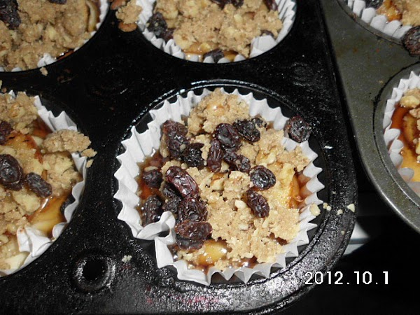 place one apple slice on top, place crumb topping and/or raisins and nuts if...